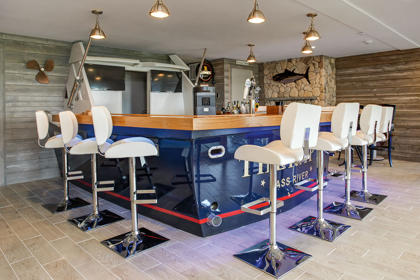 Real-life boat repurposed as a bar for a Cape Cod game room by Sand Dollar Customs builder and remodeler