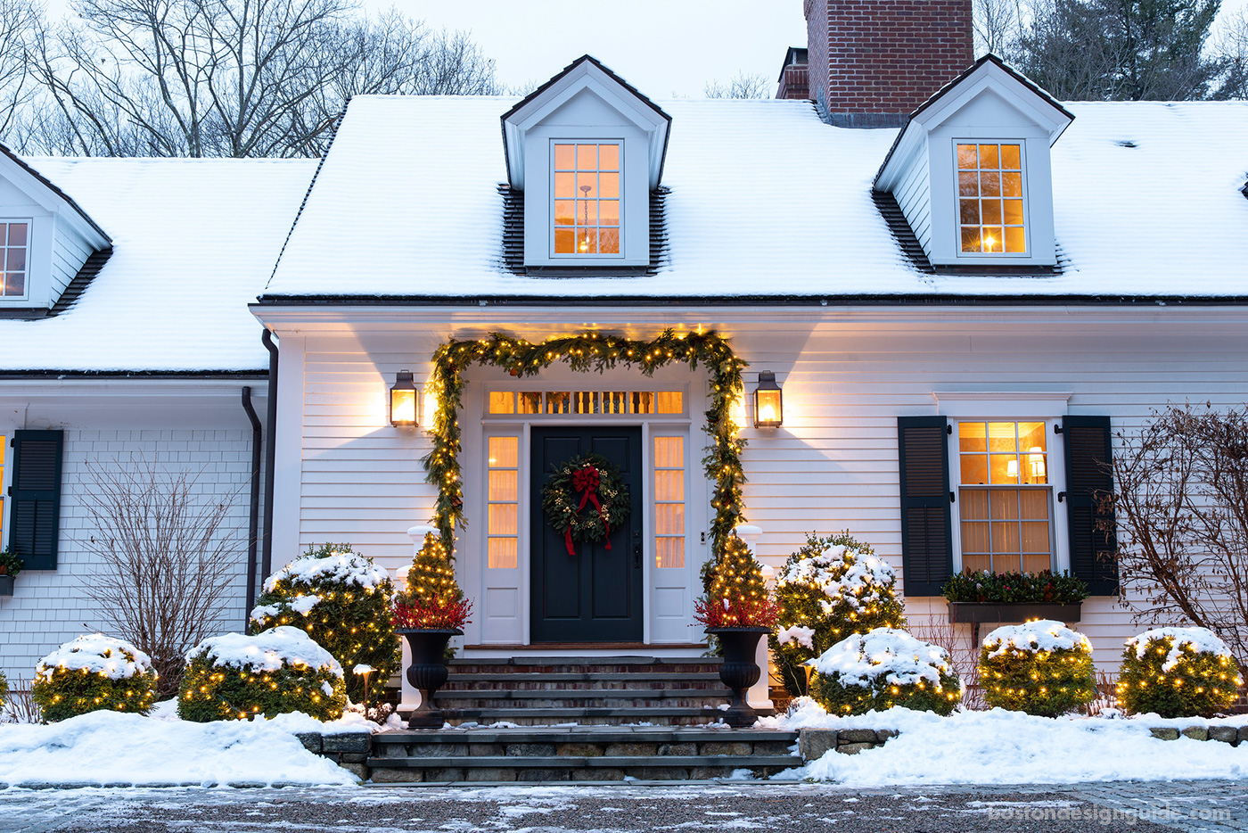 New England home dressed for the holidays by landscape design and installation firm a Blade of Grass