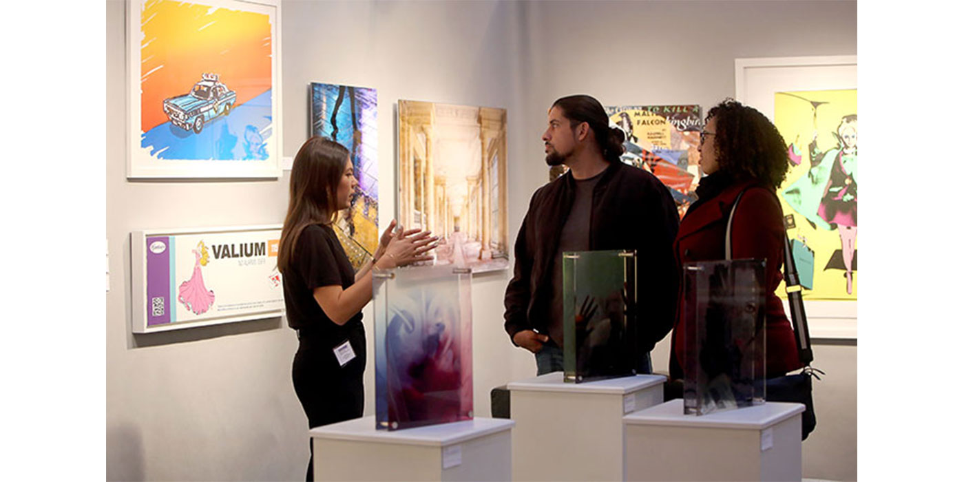 Eventgoers speak to art experts at the Boston International Fine Art Show