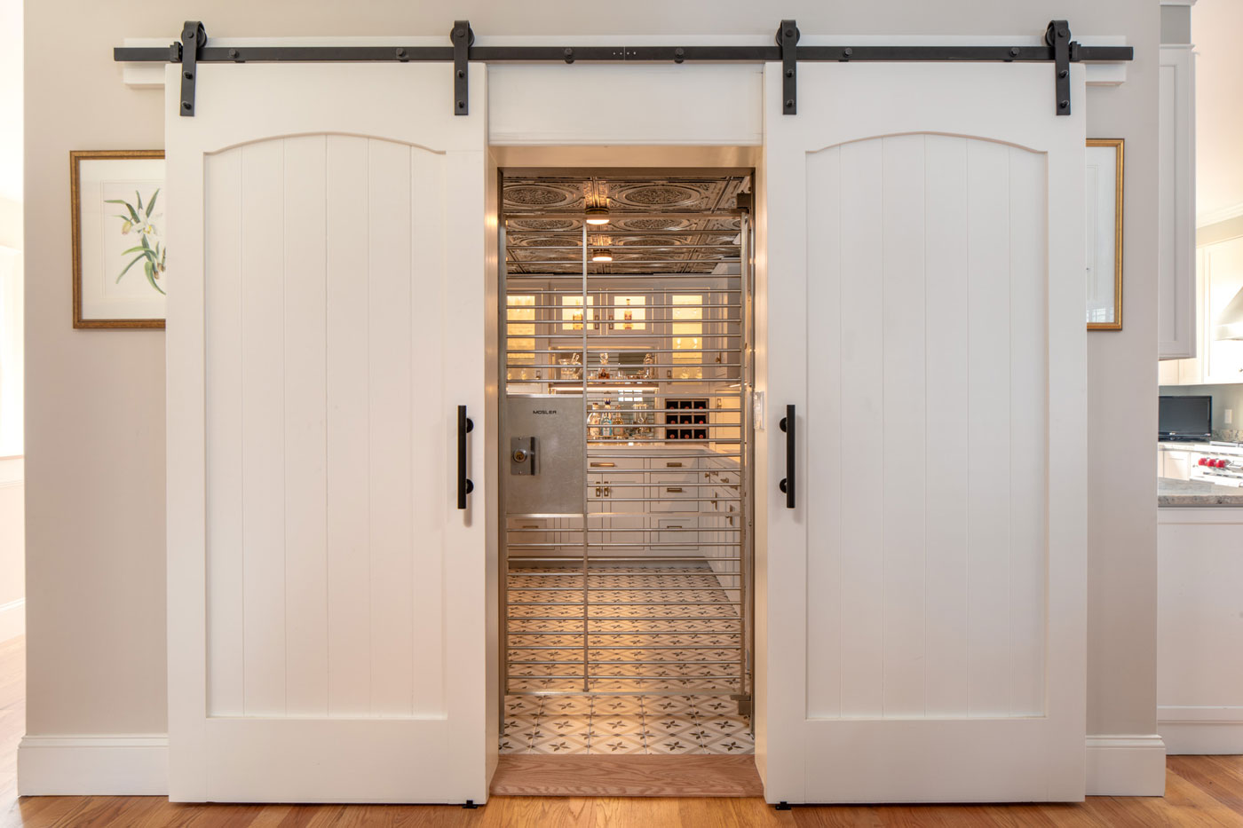white barn doors that open up to a butler's pantry converted from a bank vault