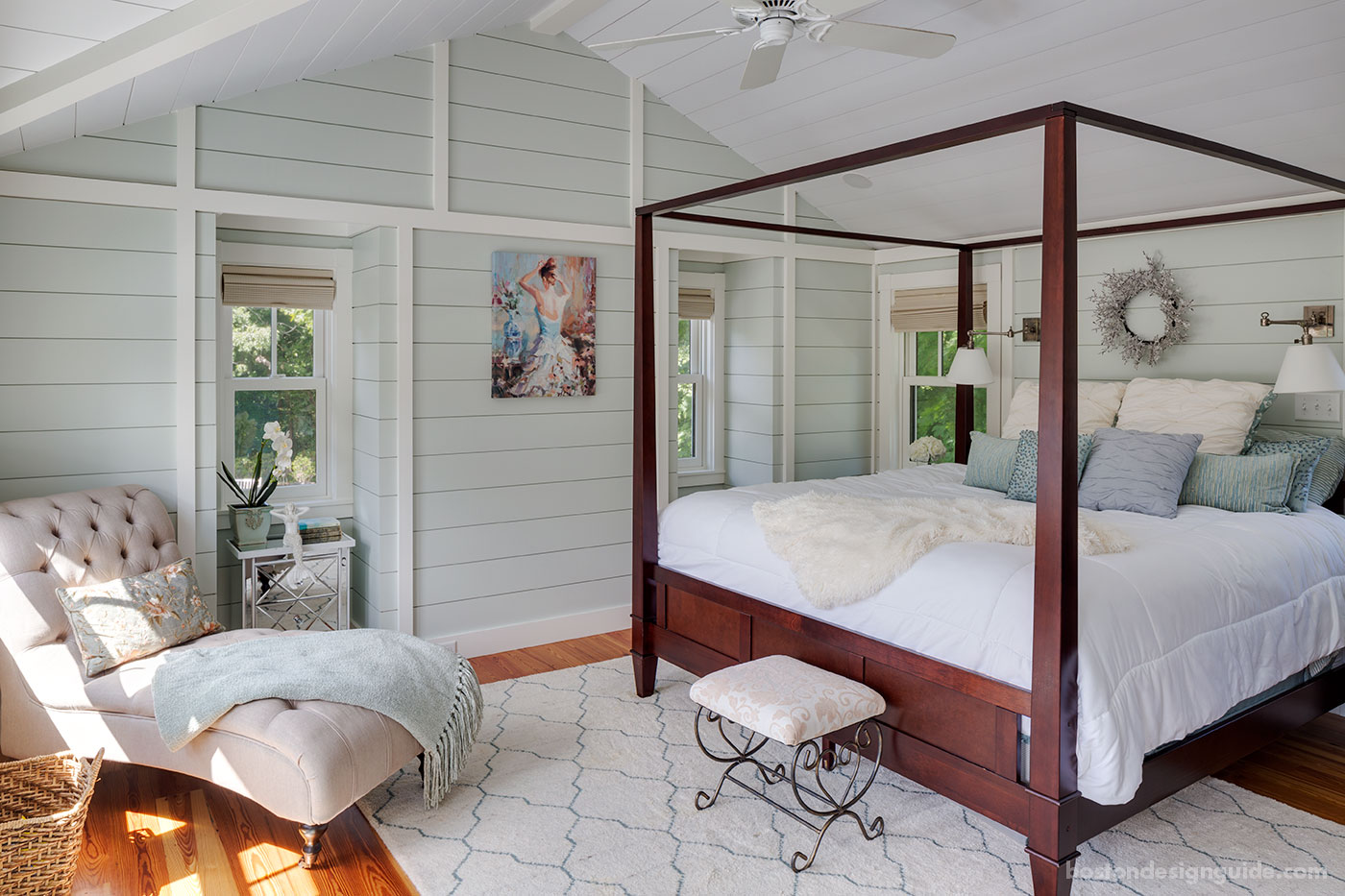 Coastal bedroom with nickel gap wood paneling by custom home builder Bannon Custom Builders
