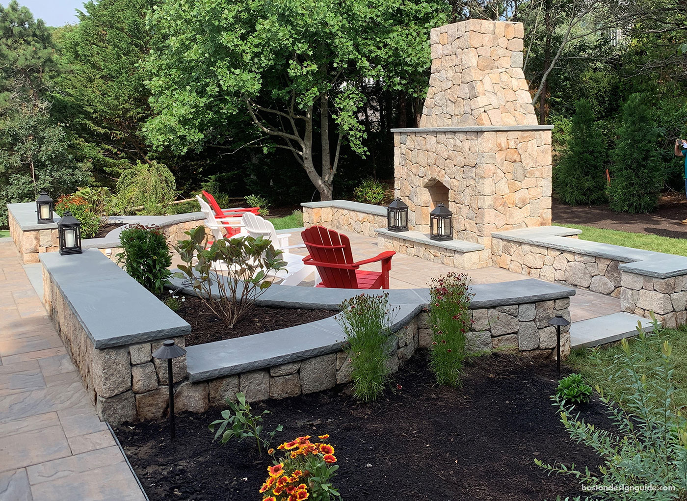 Outdoor living with custom outdoor fireplace by Blue Claw Landscape Development