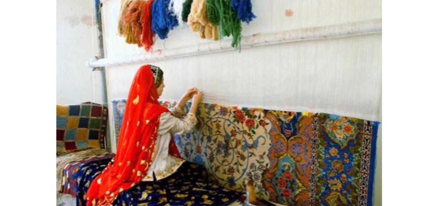 Hand making an Oriental rug