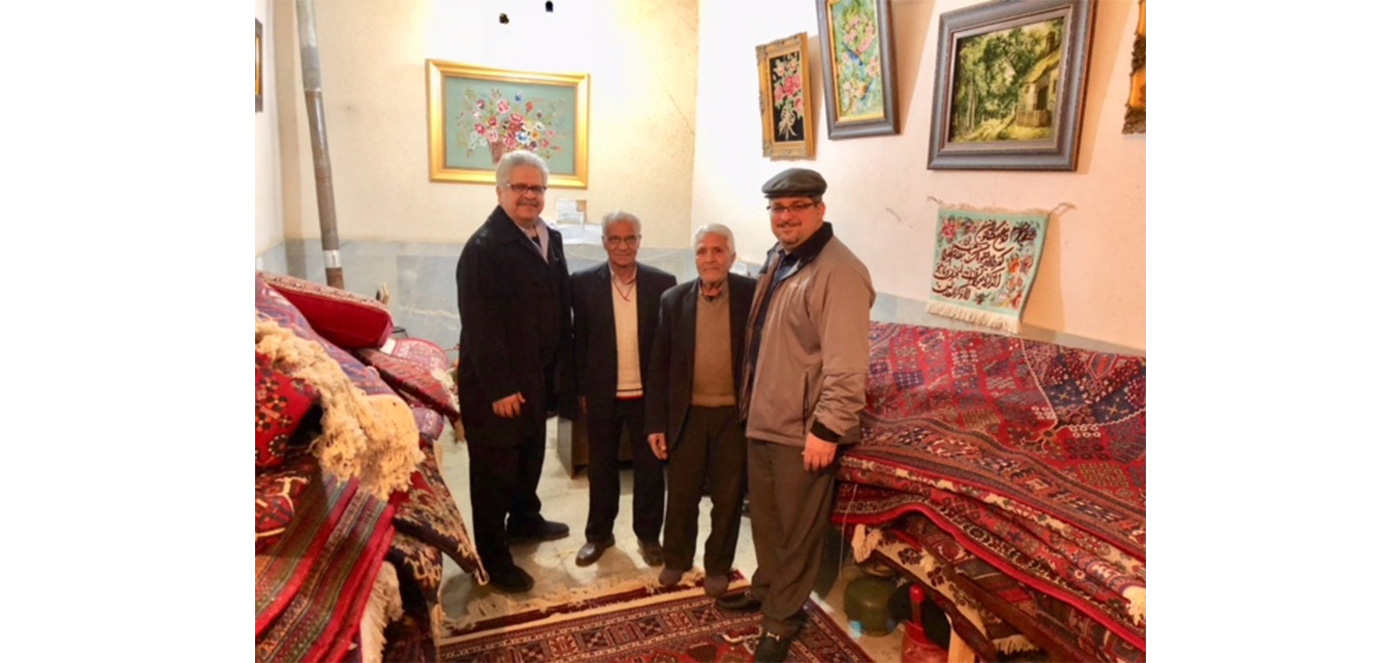 Bahman Kimiachi meets with rug shop owners in Iran