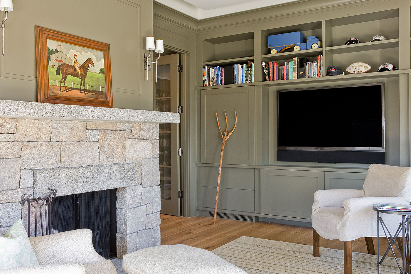 High-end transitional family room by Brookes + Hill Custom Builders