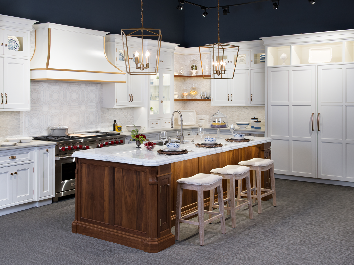 Clarke showroom kitchen with big island in the center set up for 3 diners