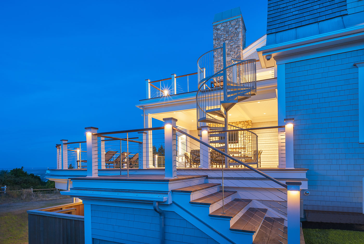 Cape Cod custom home and multi-level deck constructed by Cape Dreams Building and Design