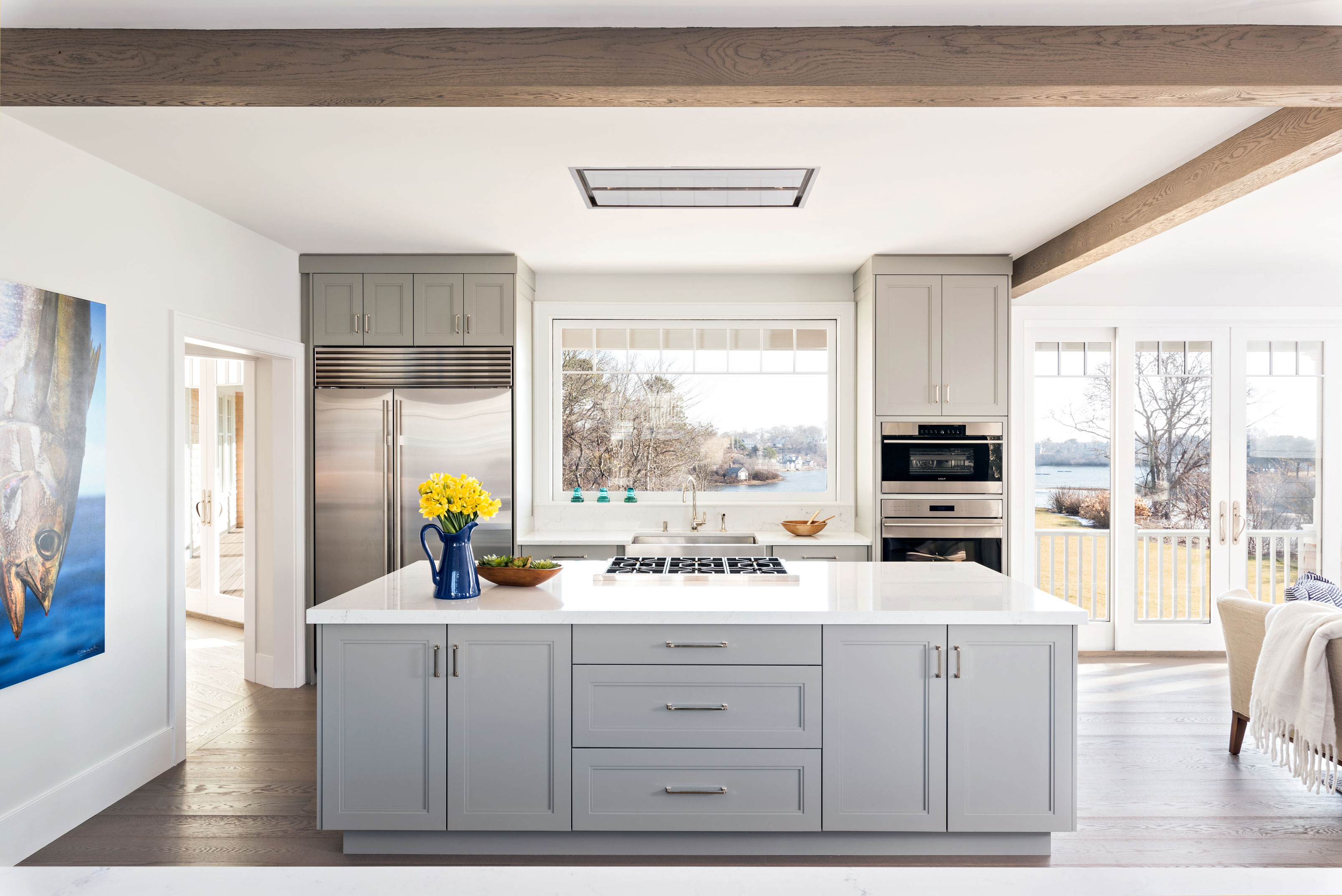 Kitchen with gray cabinets and view of water
