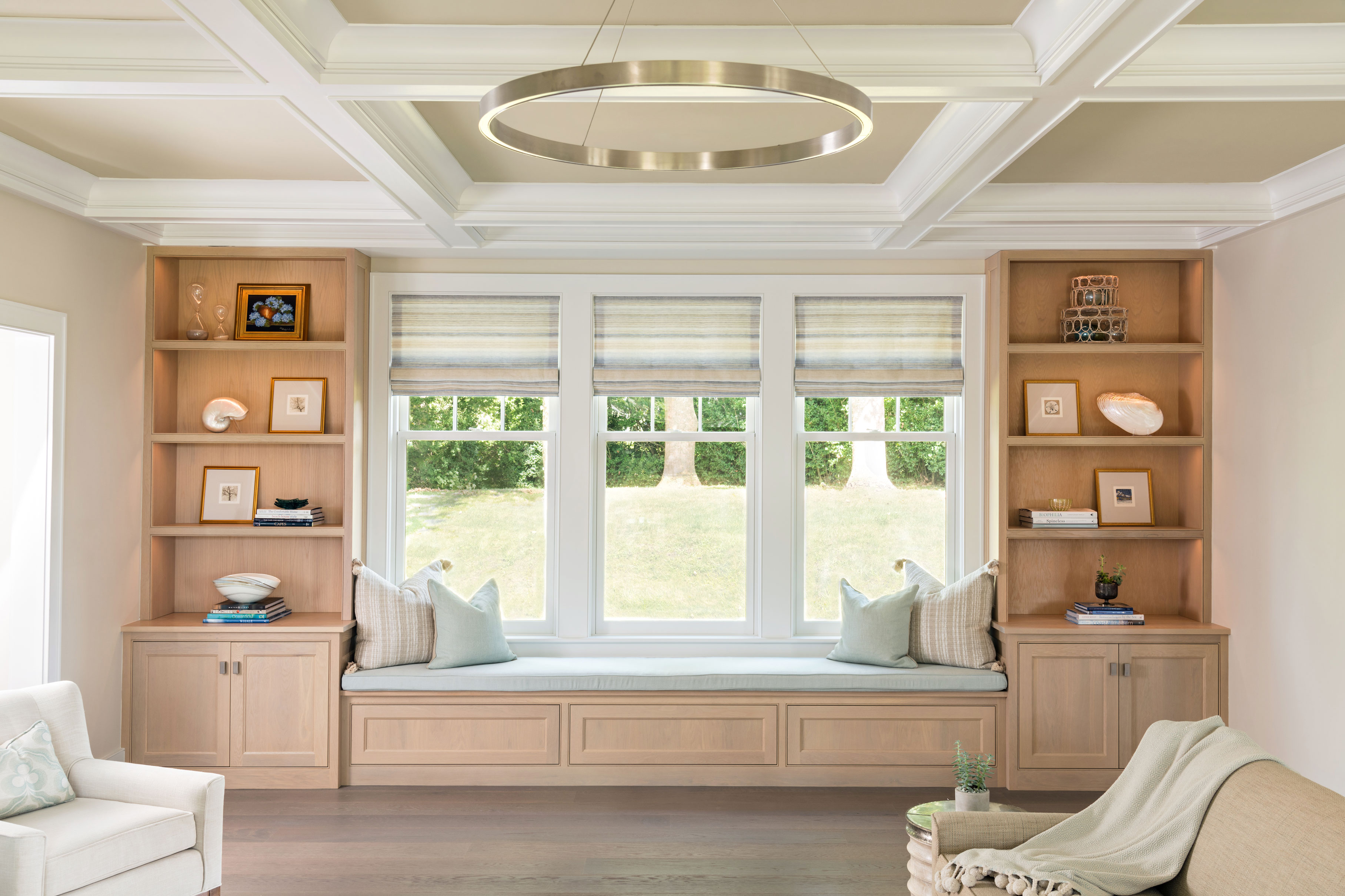 family room with custom built in window seat and shelving