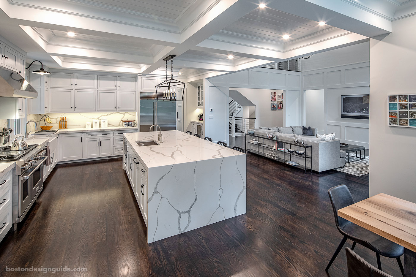 Open-floor kitchen into dining room by Concept Building Inc.