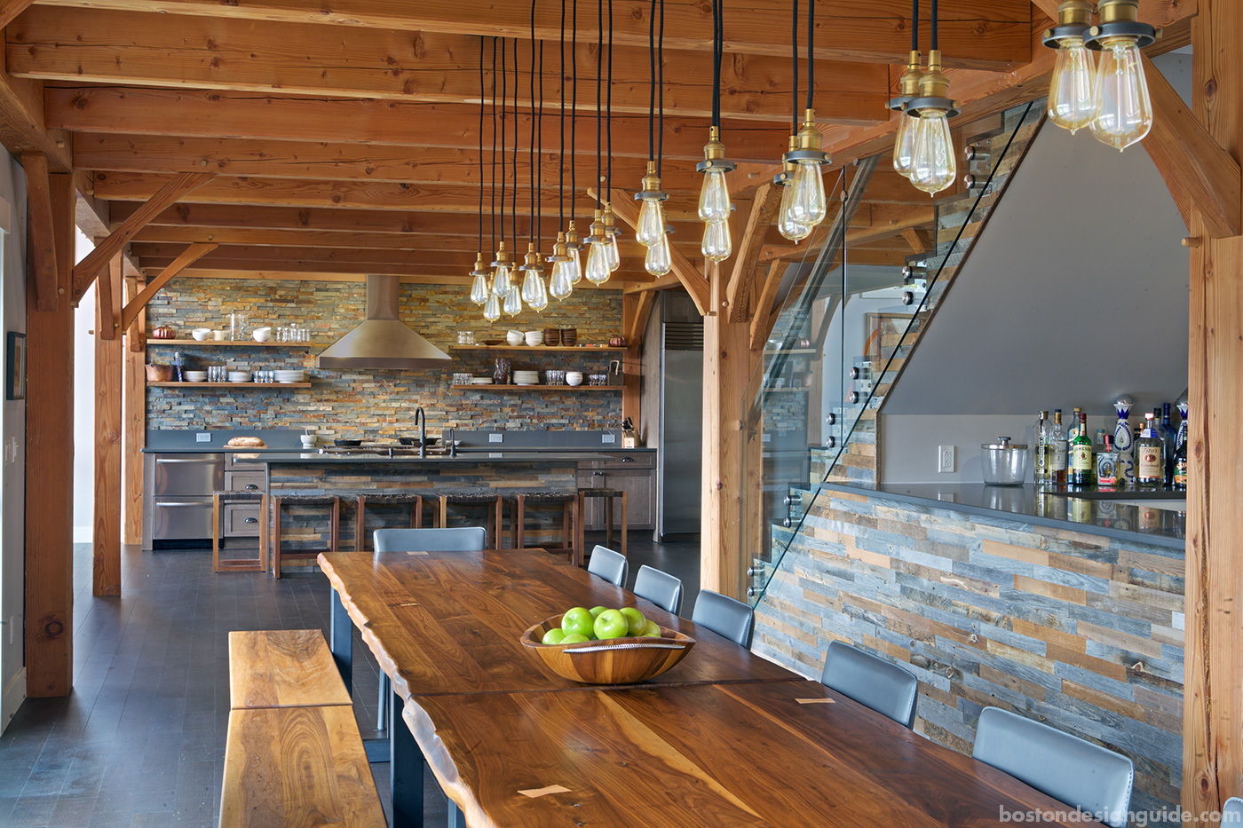 High-end custom dining room with stone for a Maine home renovation by Slocum Hall Design Group