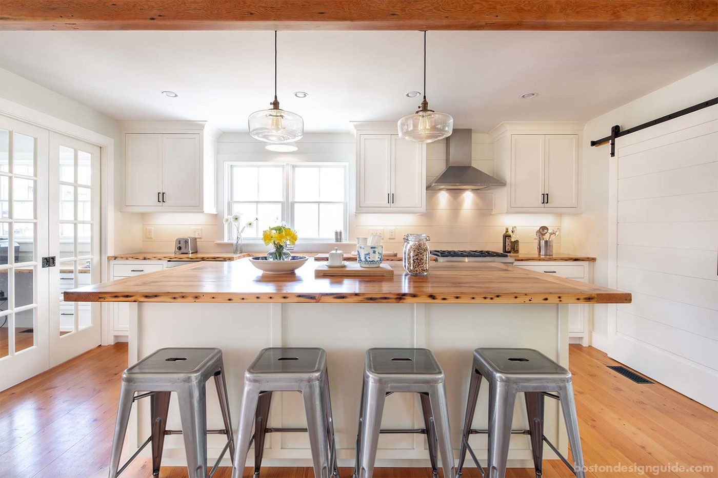 Farmhouse kitchen with nickel gap paneling by custom home builder Costello Fine Homes
