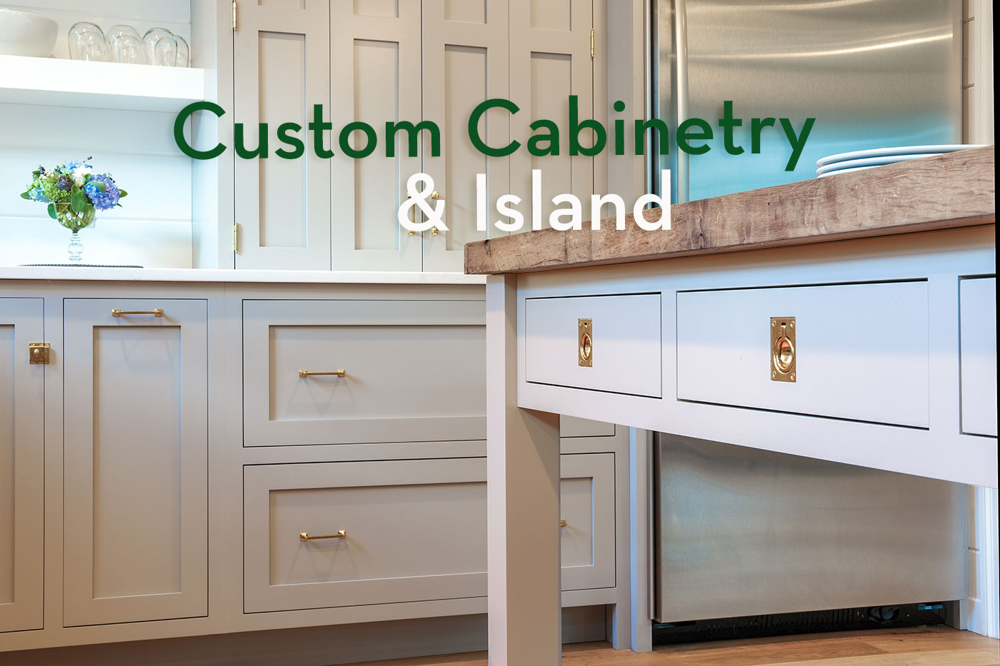 Custom cabinetry and island by Crown Point Cabinetry