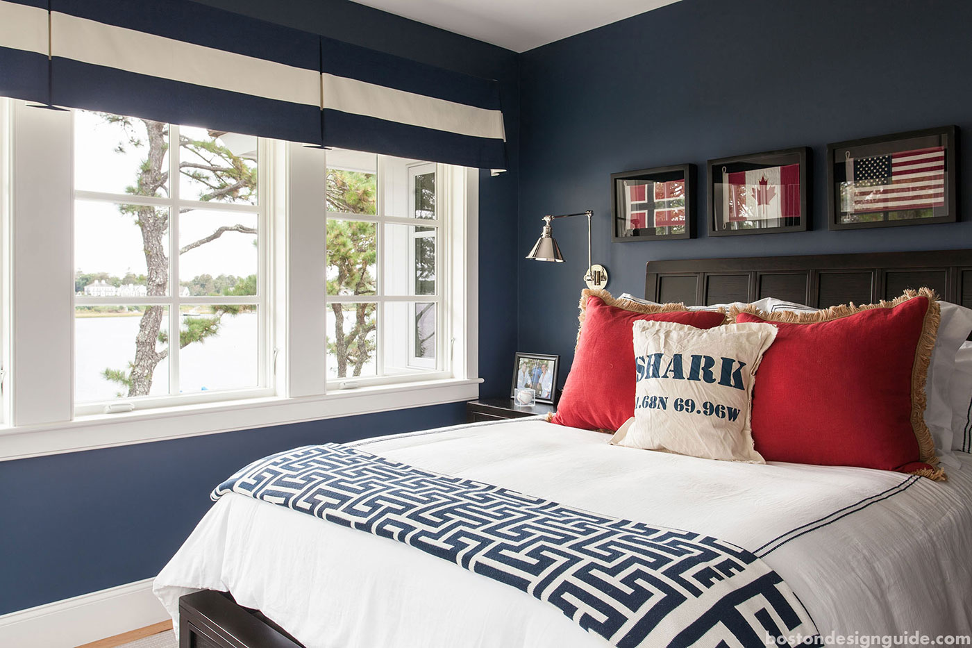 Red, white and blue bedroom by high-end builder Rick Roy Construction