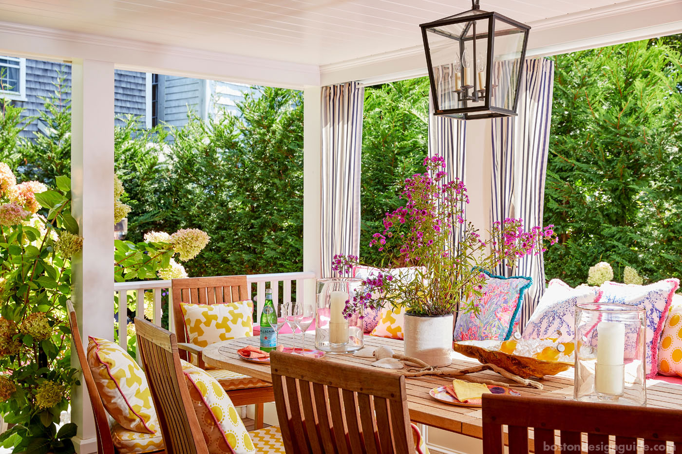 Coastal porch with curtains by Donna Elle Design