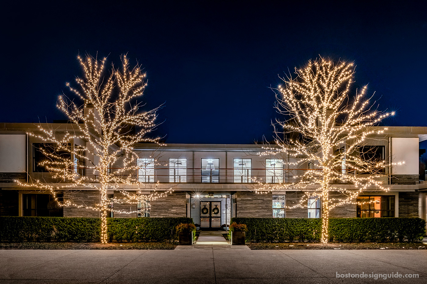 High-end contemporary home with holiday lights by R.P. Marzilli & Co.