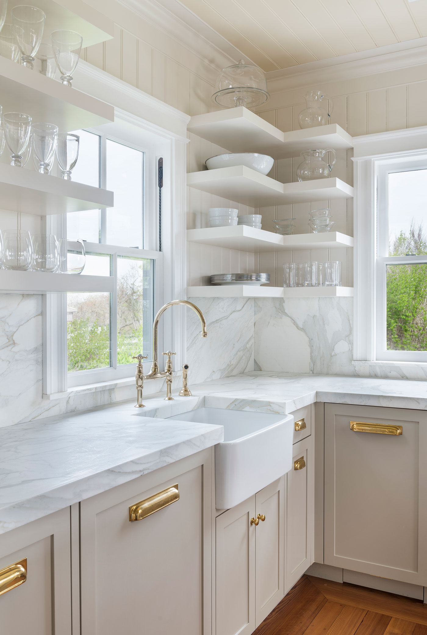 white kitchen with open shelving and apron sink