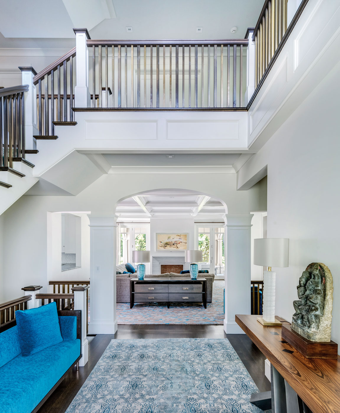 Stair hall of a high-end custom suburban Boston home designed by architect Morehouse MacDonald and Associates and constructed by Sanford Custom Builders.