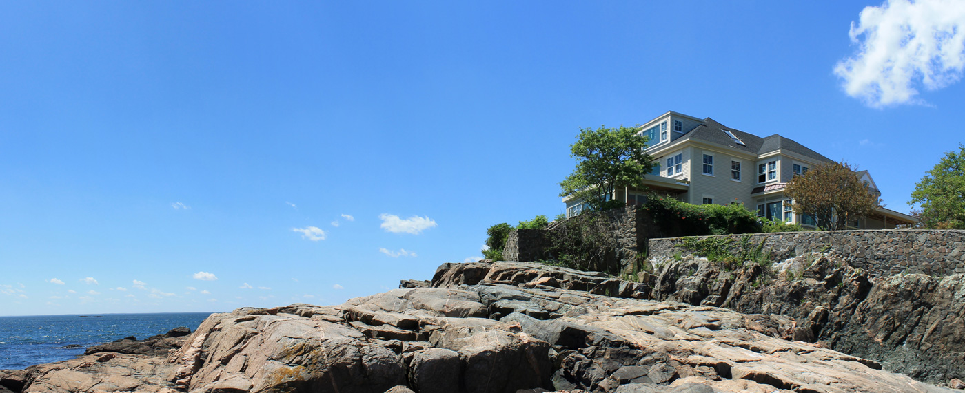 Ultra modern makeover for a traditional oceanfront home in Marblehead by Groom Construction Co.