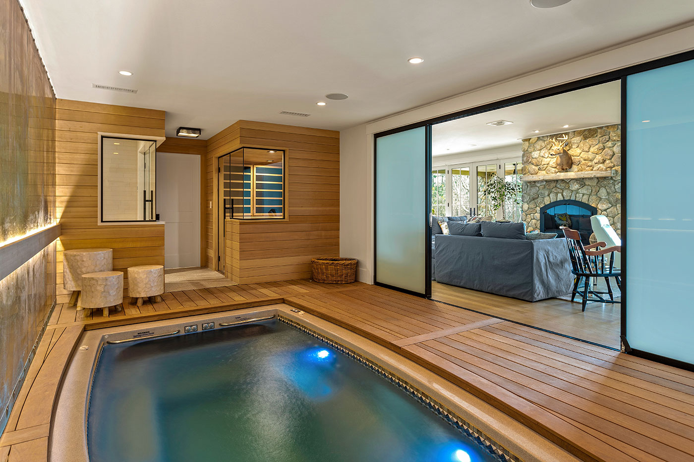 Indoor pool and lower level of a Cape Cod oceanfront home by Gakidis + Stewart Design Group
