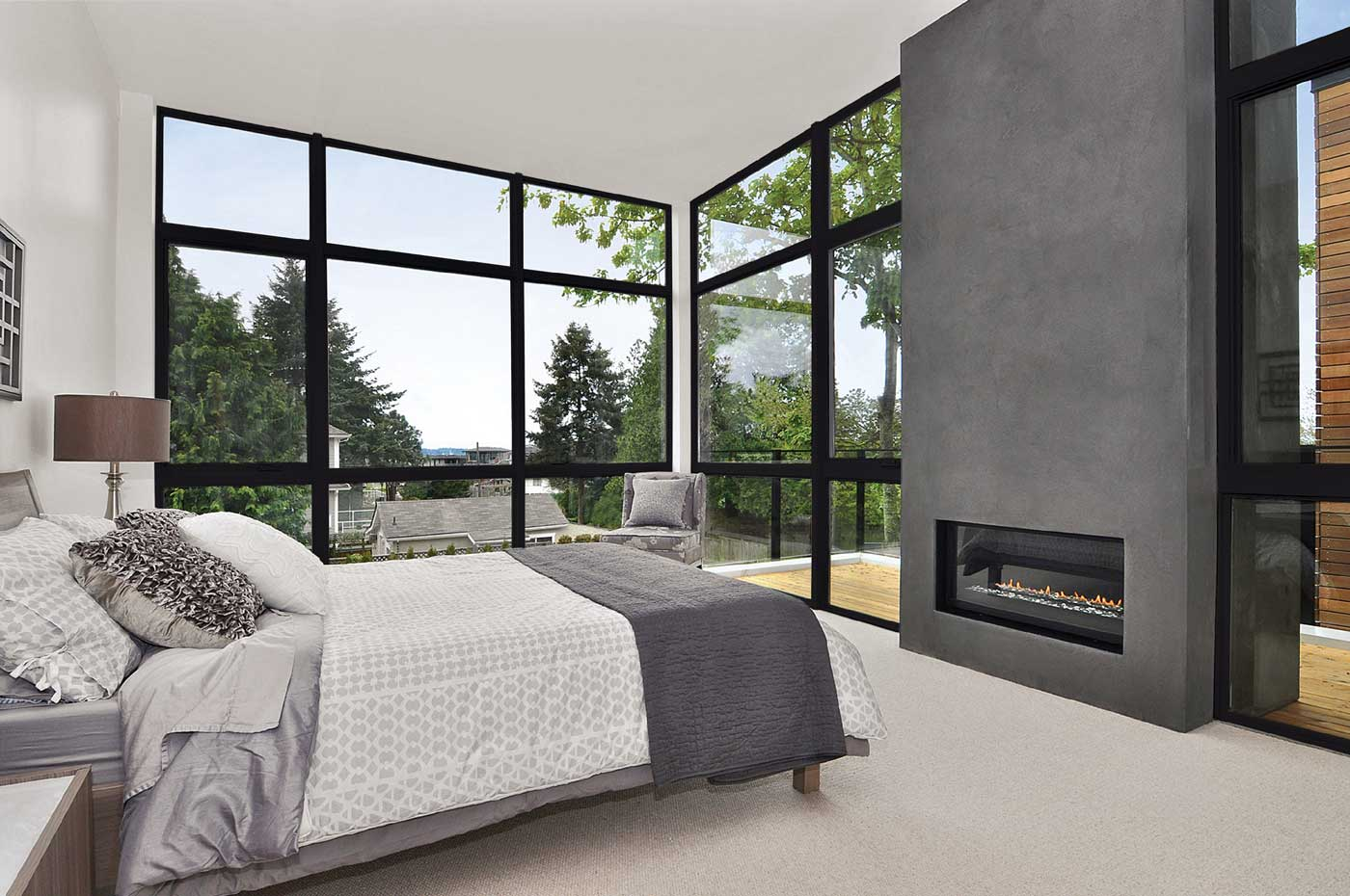 bedroom with big windows and fireplace