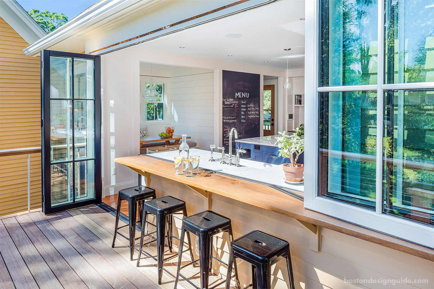 Indoor/outdoor kitchen by JW Construction