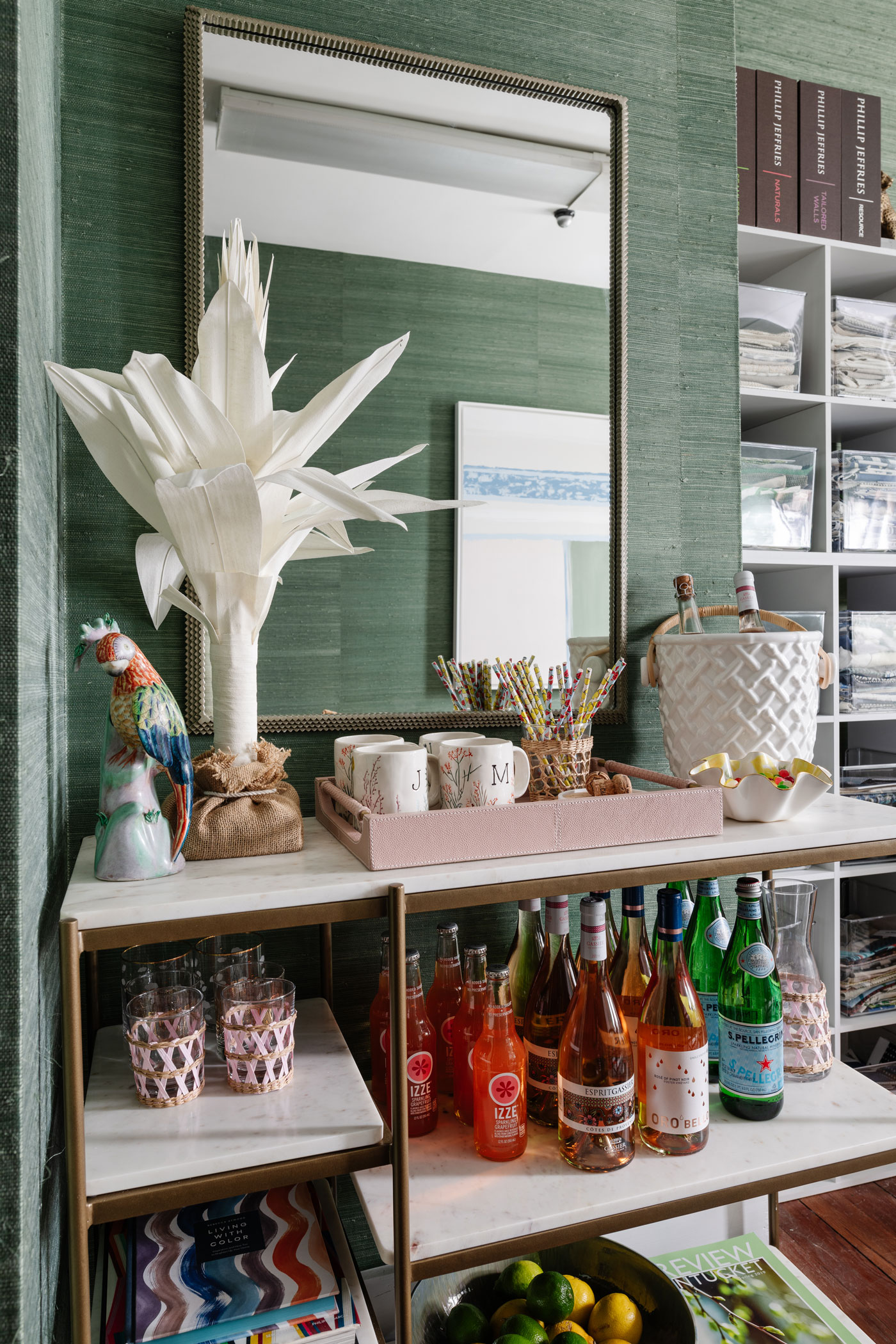 shelving in the corner of the office with drinks, glasses, straw and mugs