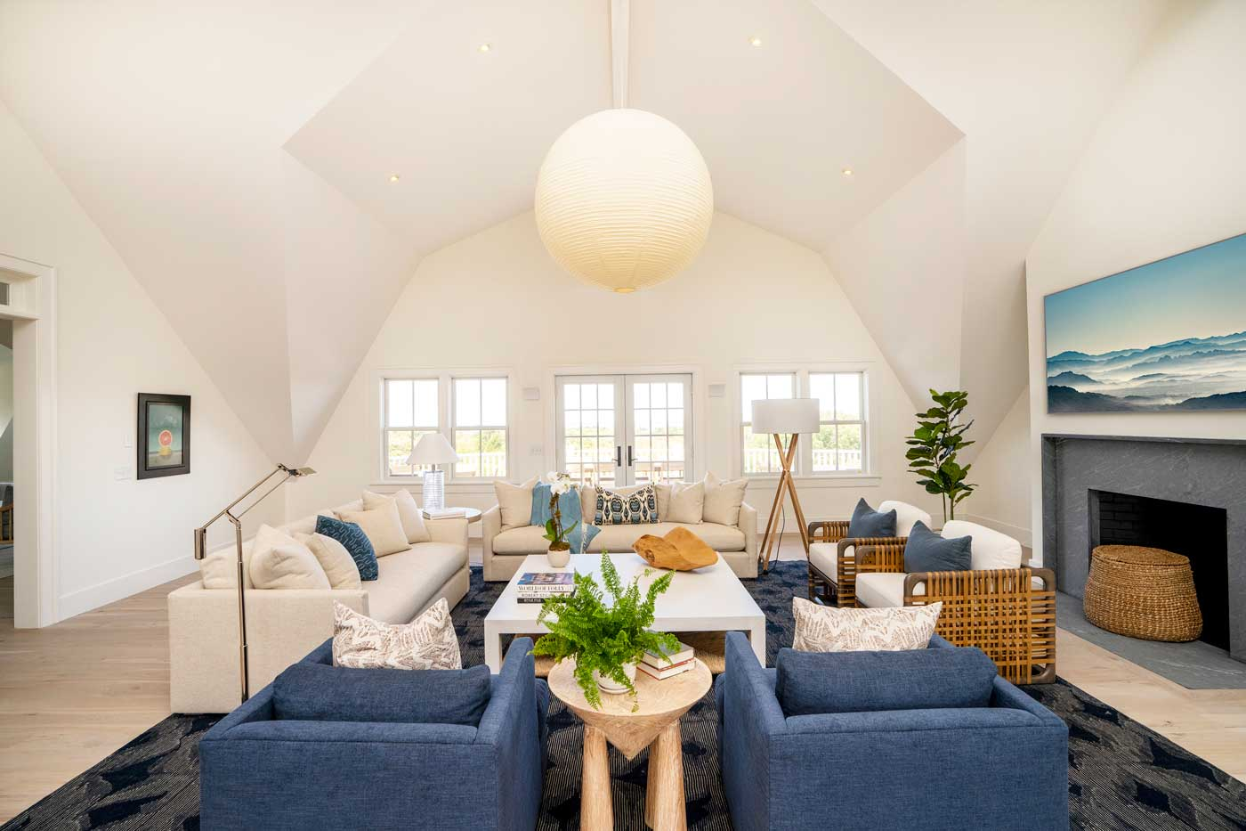 family room with off white sofas blue chairs and cathedral ceiling
