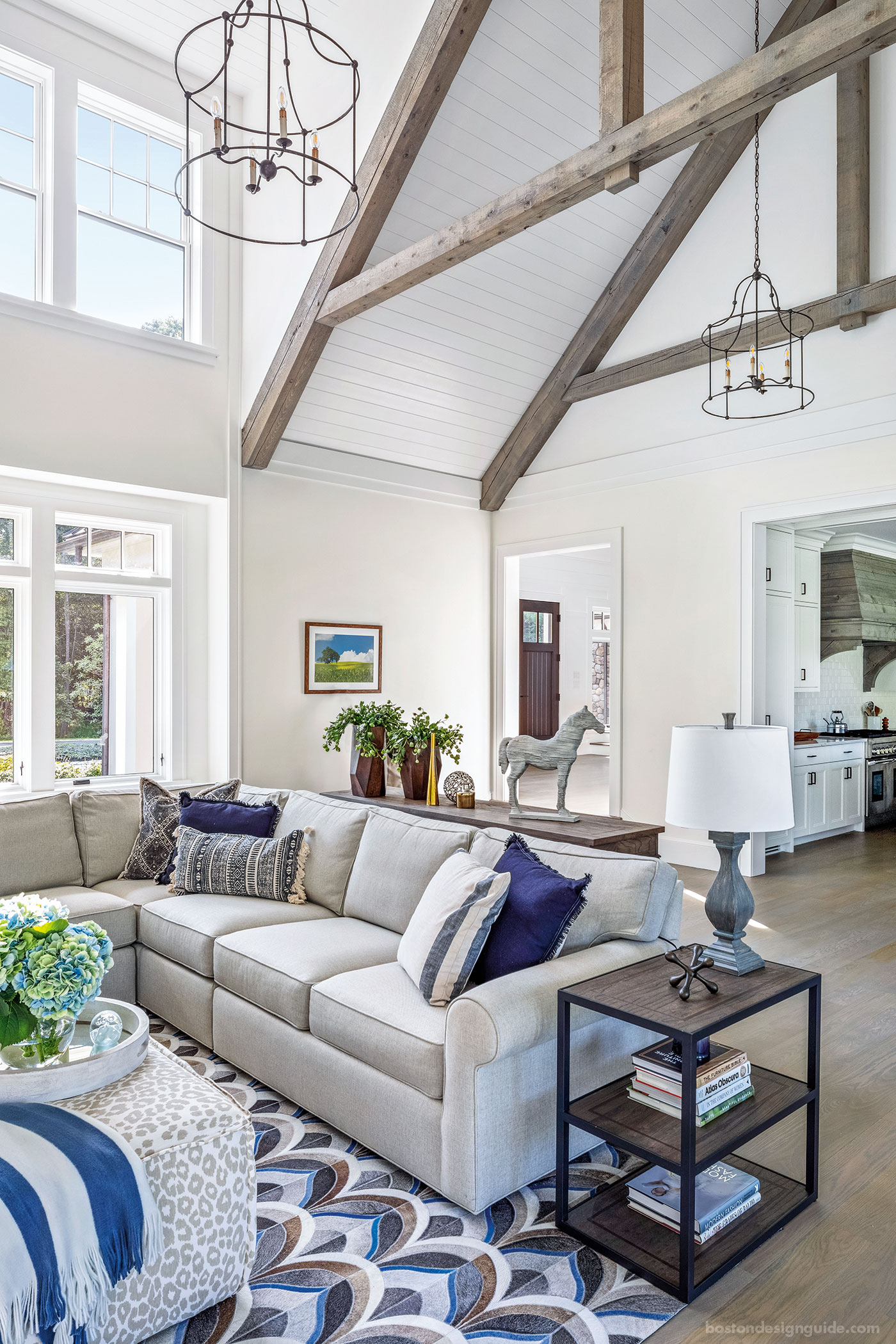 Great room with cathedral ceiings in a farmhouse style New England home
