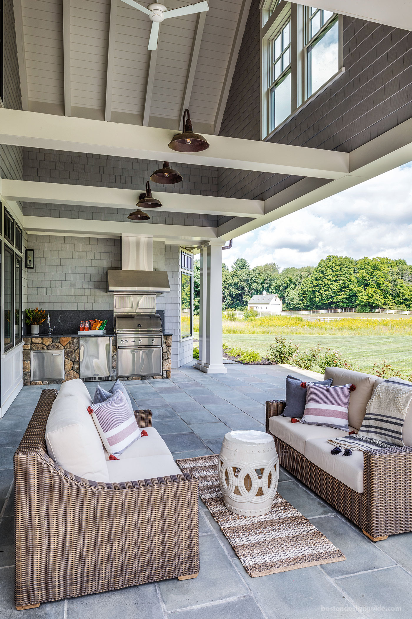 Deep-set covered porch overlooking New England pasture