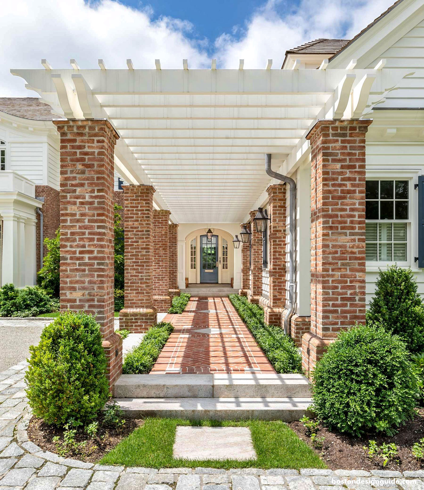 Front entry of home with Pergola overhang