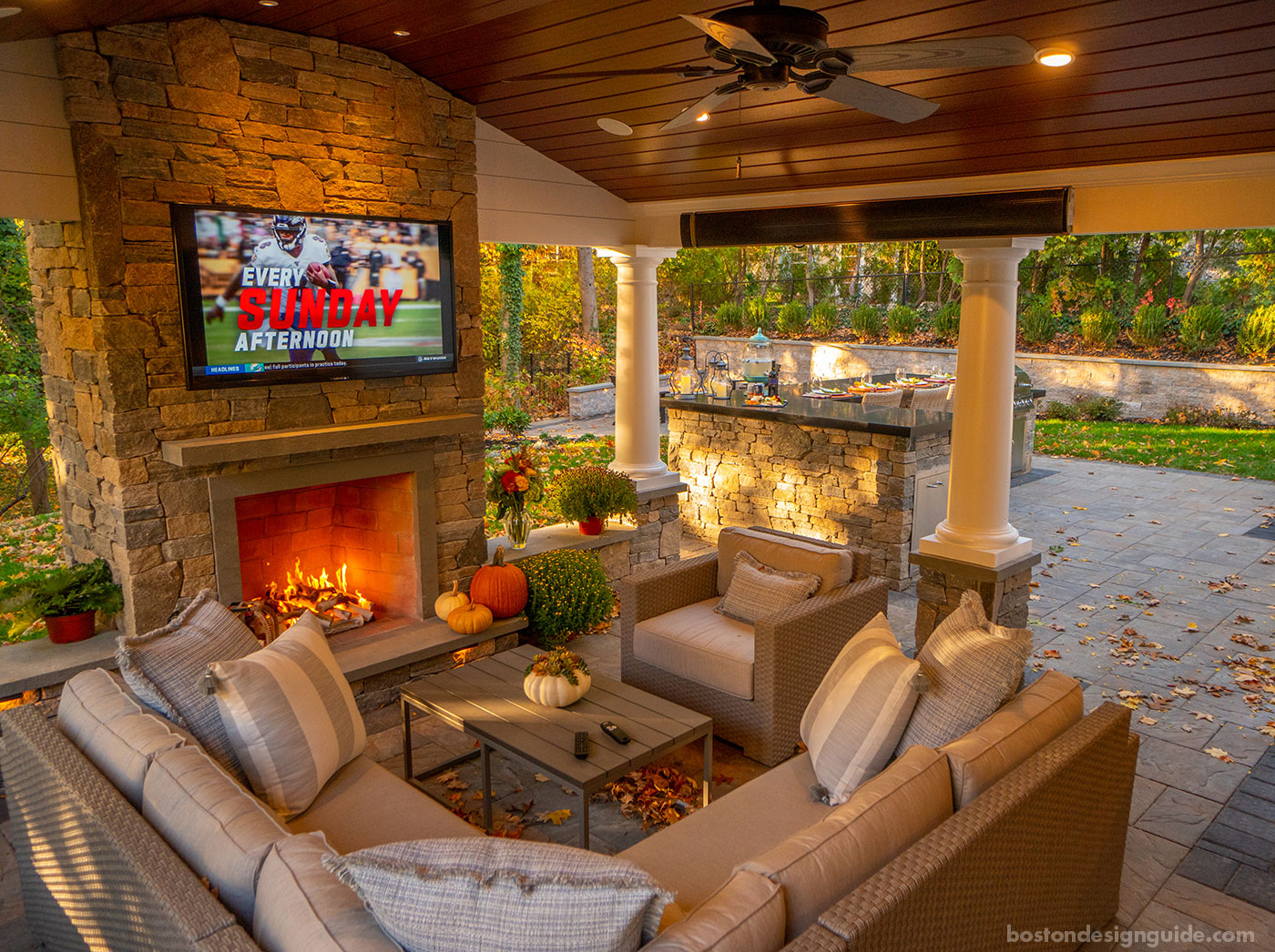 Outdoor porch with TV, fireplace and heaters by Land Design Associates
