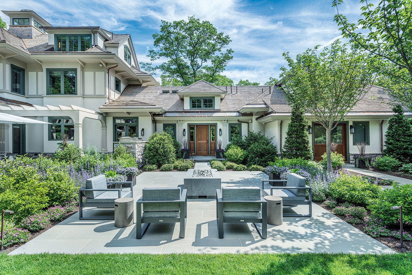 Outdoor living room by Gregory Lombardi Design with landscape construction by Landscape Creations