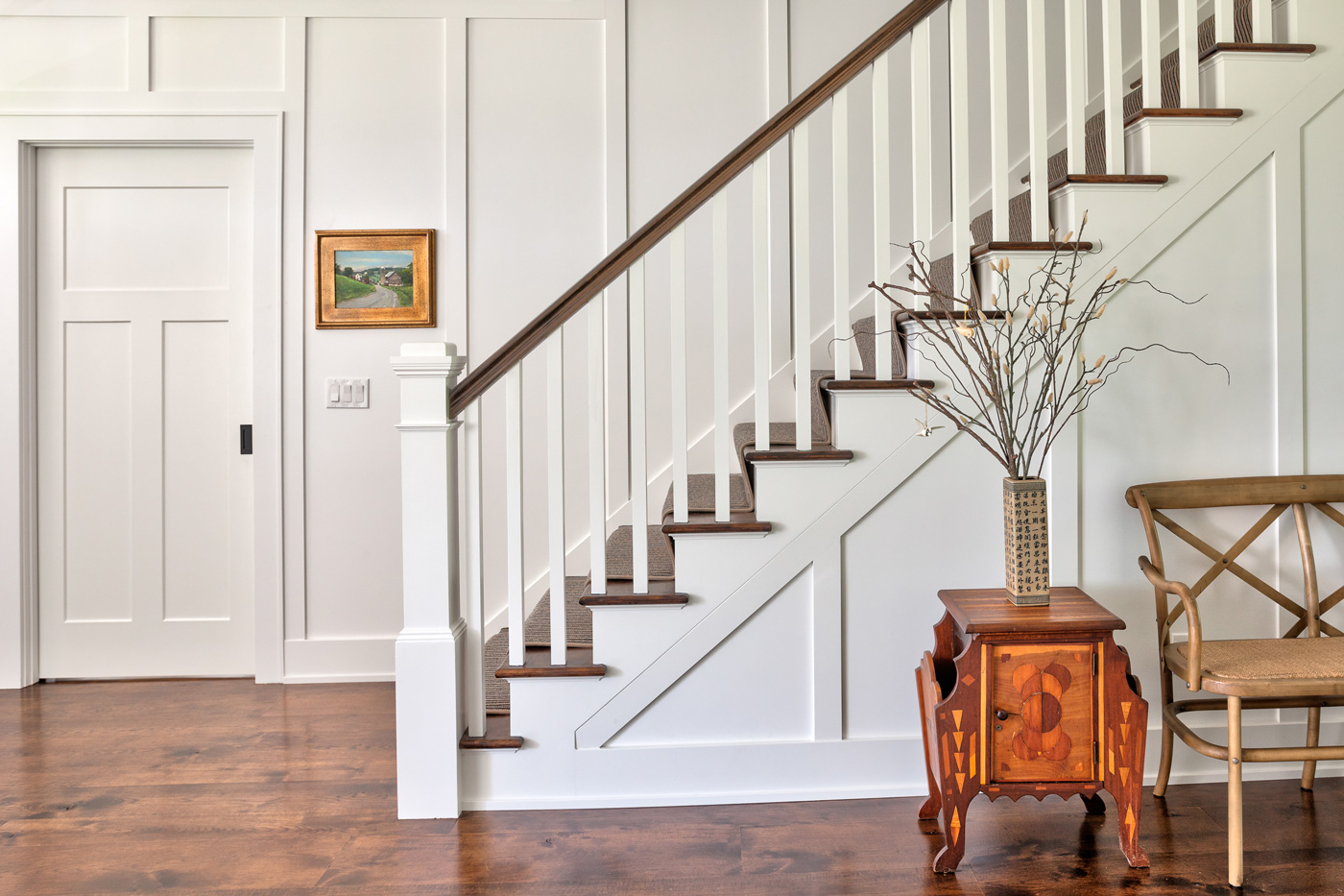 Staircase with custom wainscoting, Laplante Construction