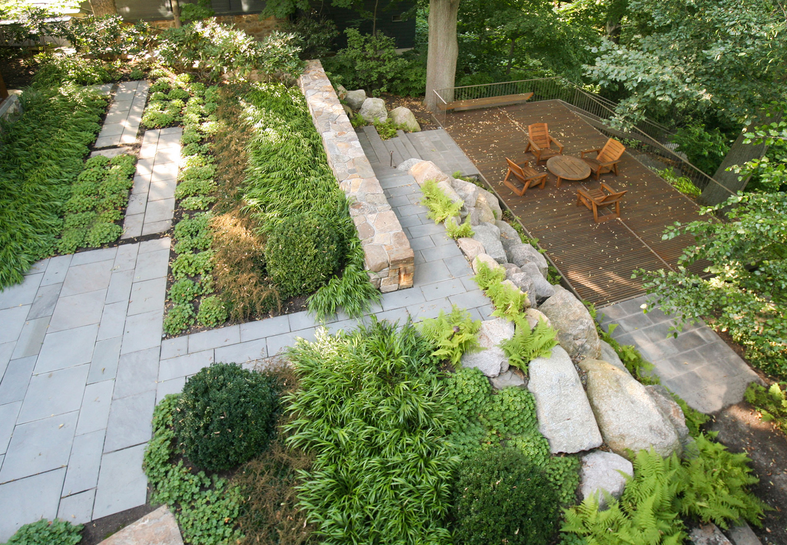 Woodland landscape setting by LeBlanc Jones Landscape Architects