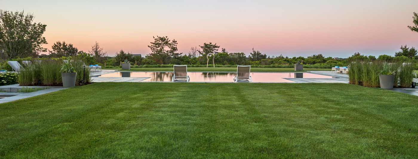 Custom coastal compound and pool terrace by landscape architect Gregory Lombardi Design