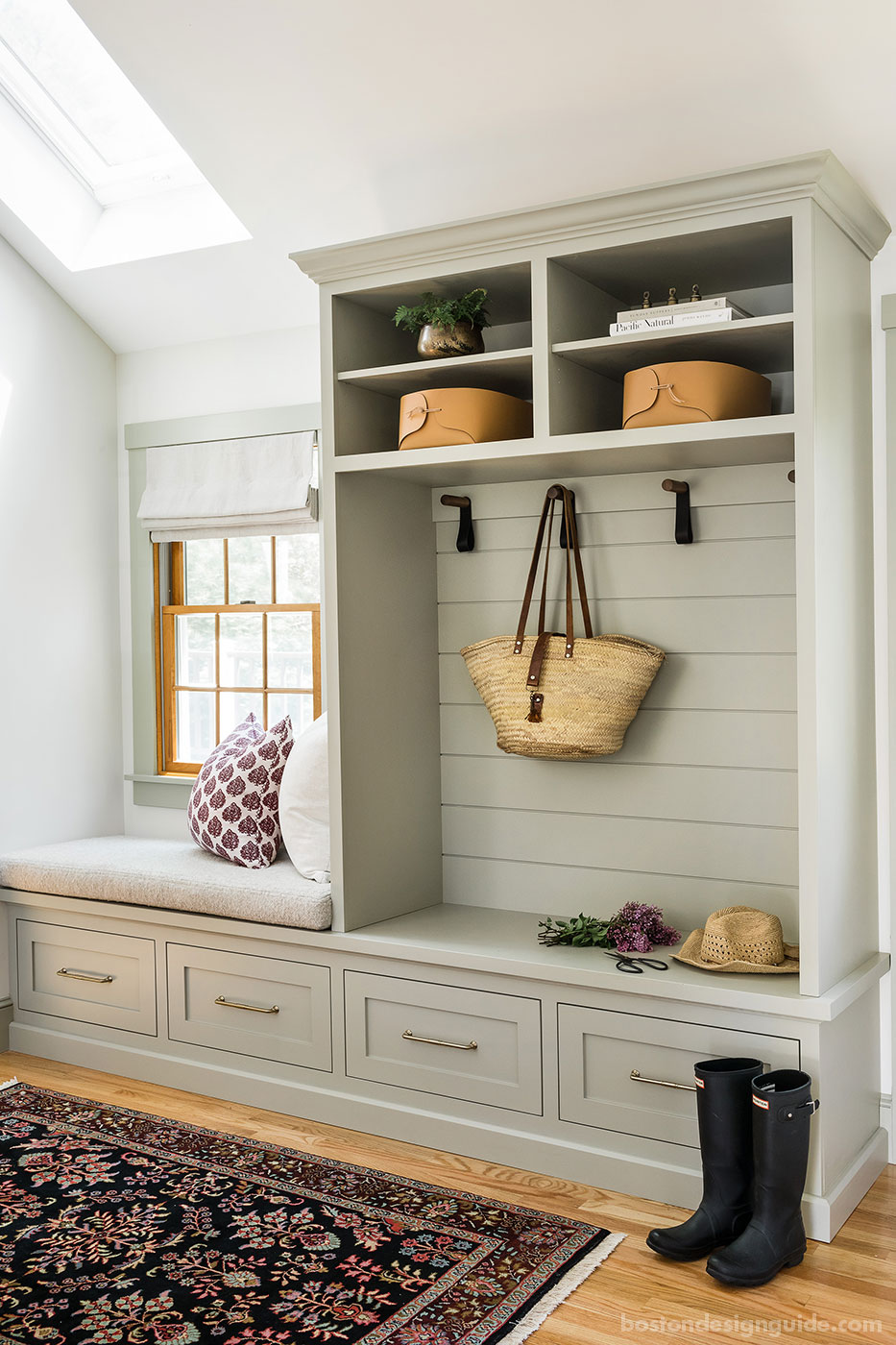 Renovated mudroom with nickel gap custom cabinetry by Mackenzie & Co.