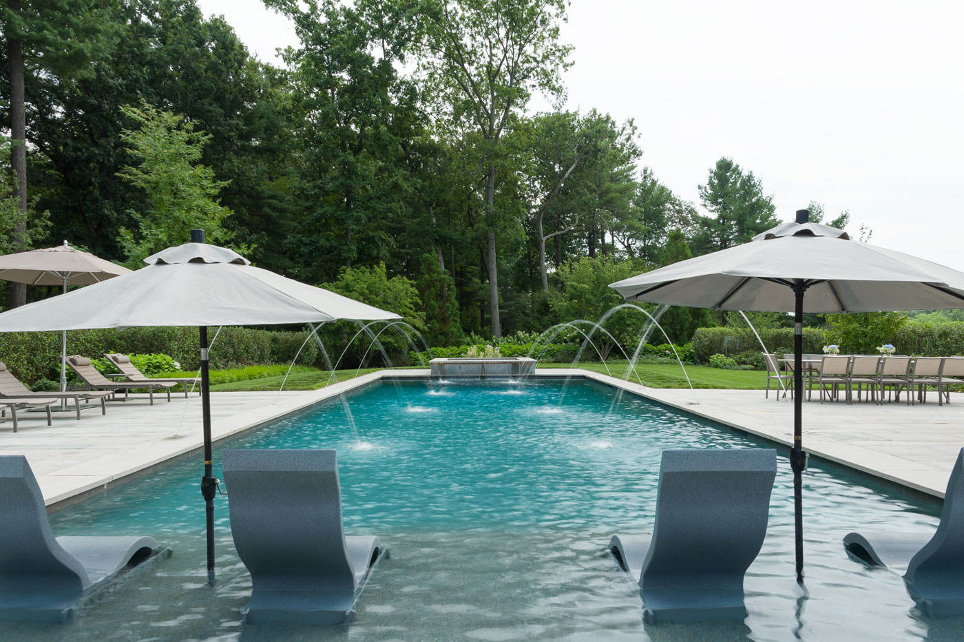 Custom pool terrace by high-end landscape professionals R.P. Marzilli