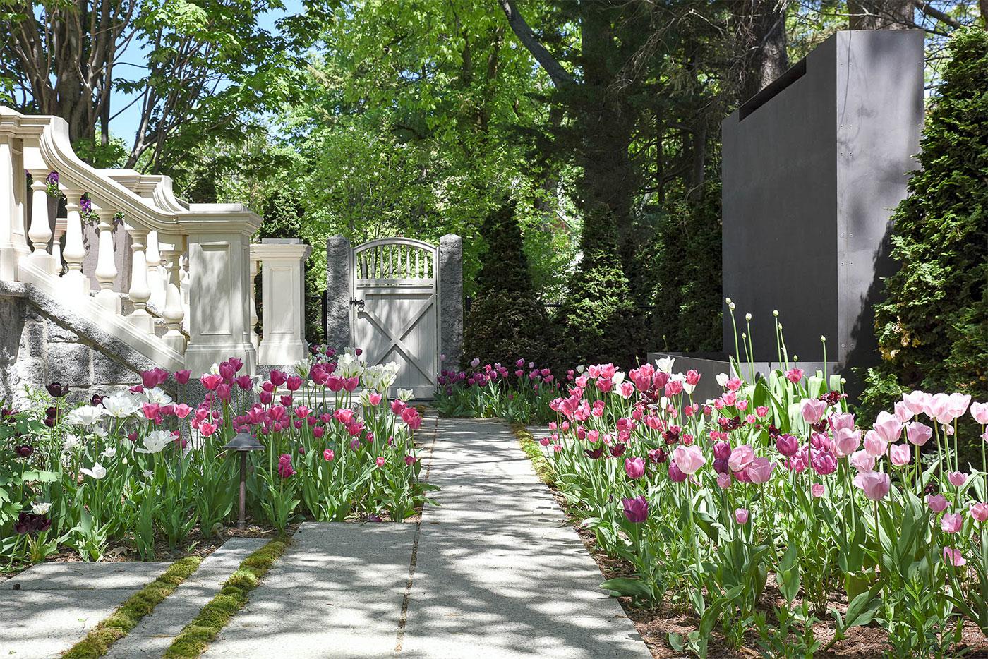 A flower-lined gateway by Matthew Cunningham Landscape Design