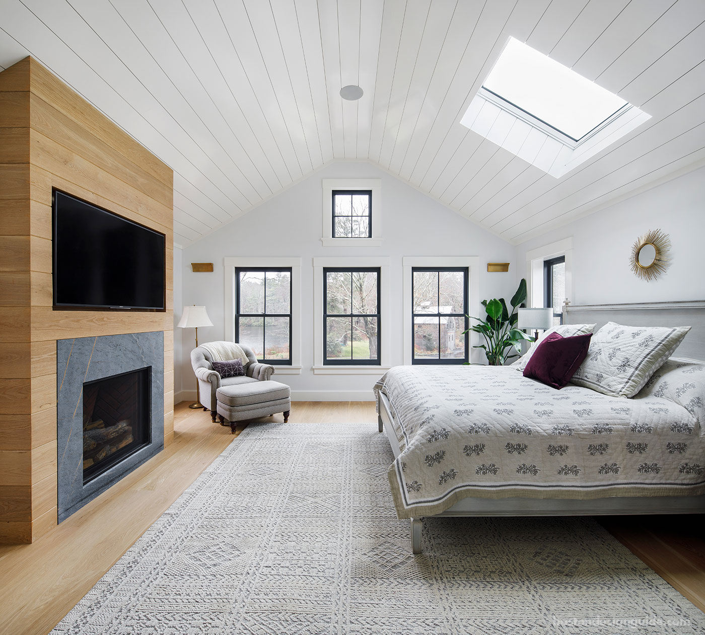 Master bedroom by custom home builder McCormack Buiilders with nickel gap wood paneling