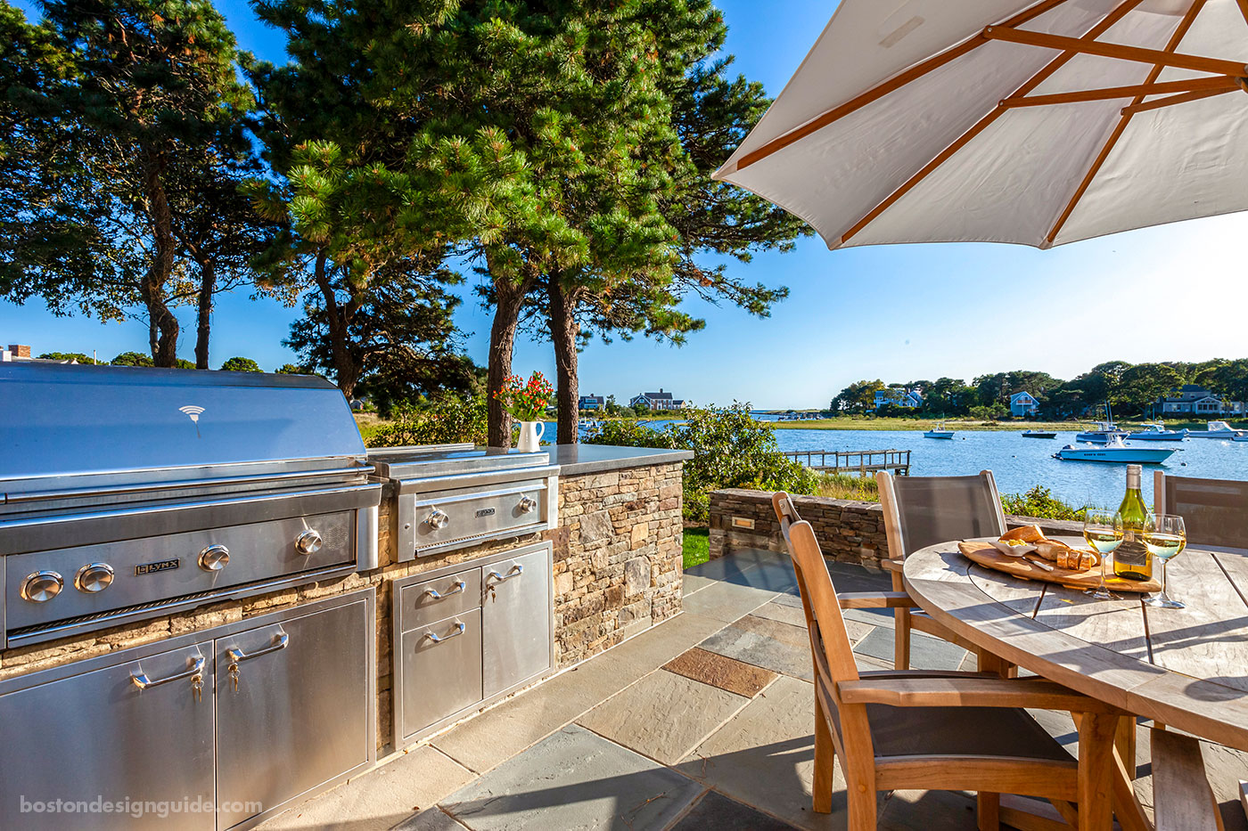 Outdoor kitchen and dining terrace by McPhee Associates of Cape Cod