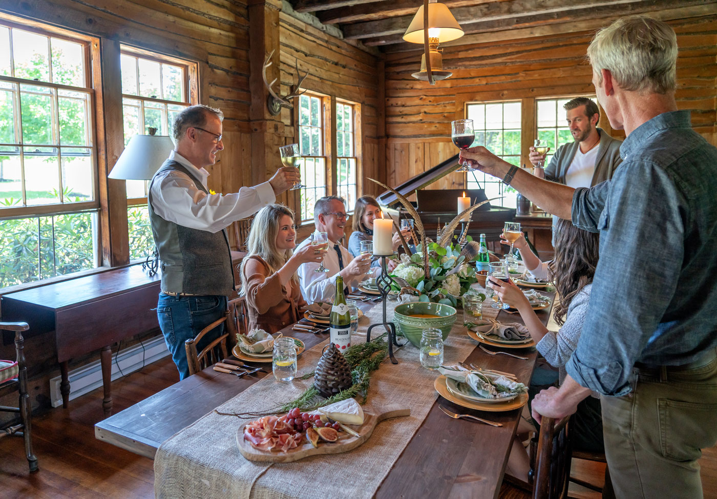 The staff at Carter & Company celebrating at interior designer Michael Carter's New Hampshire retreat