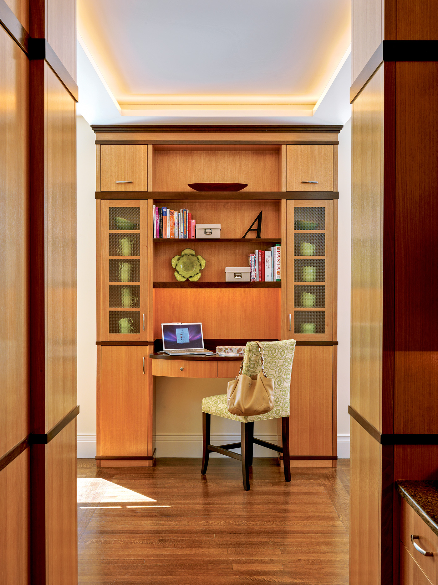 Home office space with custom millwork in a hallway design by Nicholaeff Architecture + Design