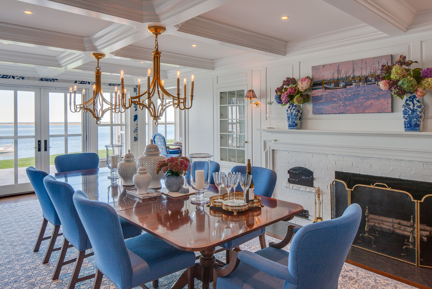 Dining area over looking the water on Cape Cod renovated by Polhemus Savery DaSilva Architects Builders