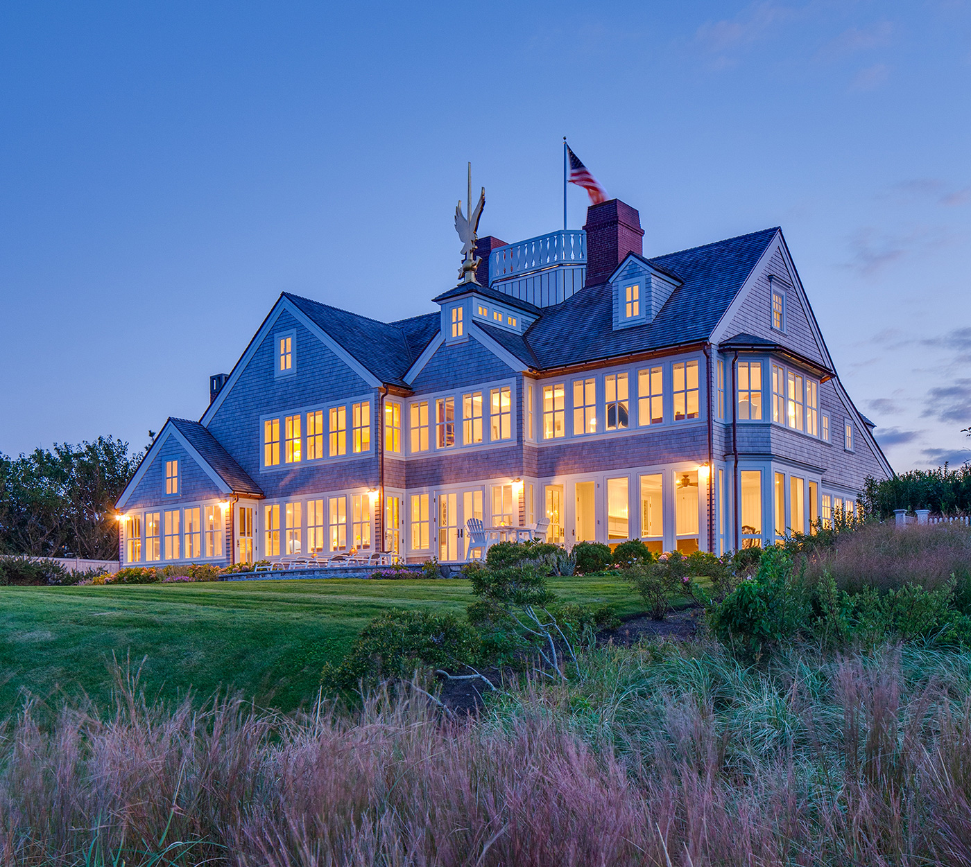 Dusk shot of Cape Cod waterfront home