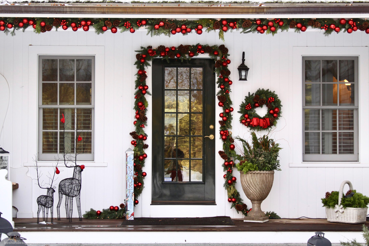 New England home in red holiday decorations by Parterre Garden Services