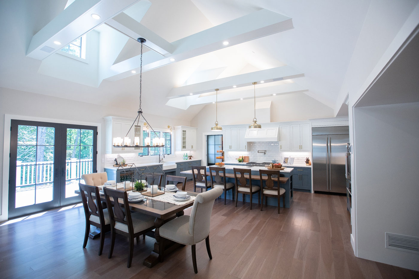 Vaulted living room/dining room and kitchen of a specially adapted smart home, constructed through the R.I.S.E. program at the Gary Sinise Foundation