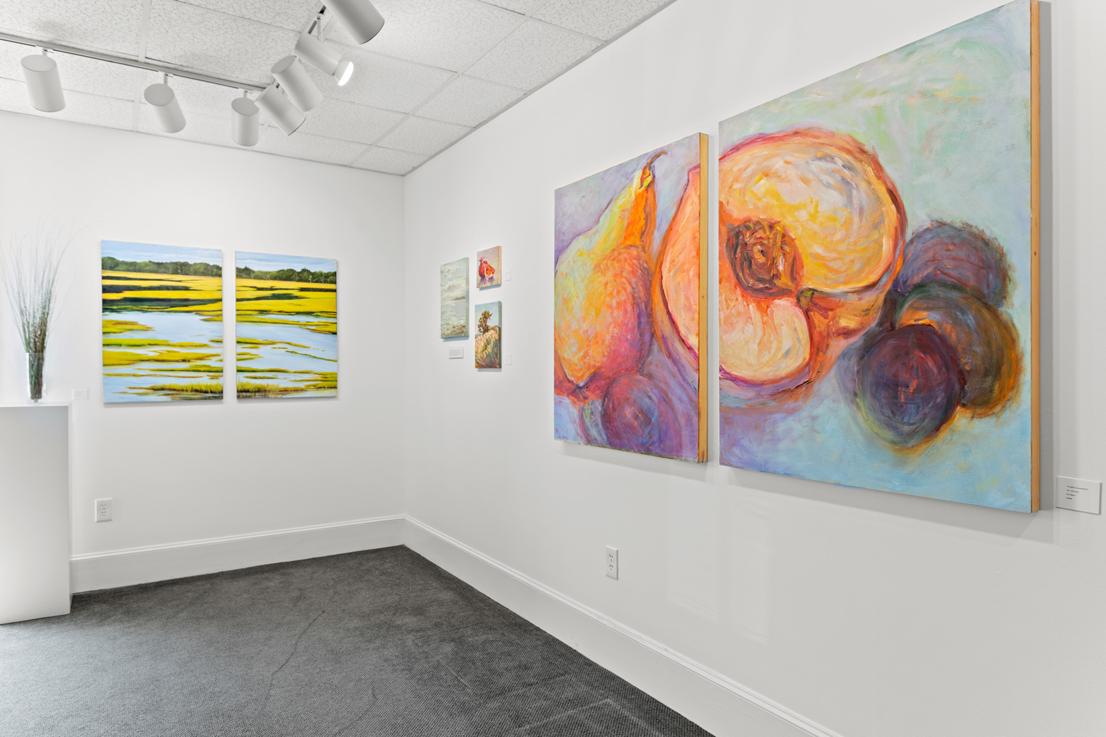 hanging art in the River Shops show room