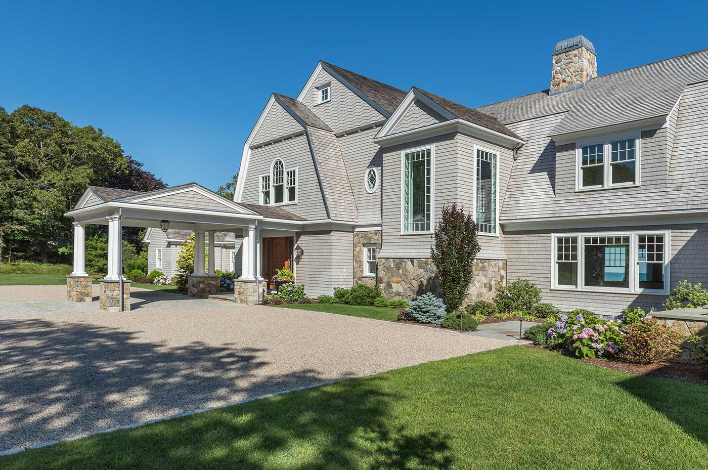 Cape Cod custom home with a porte-cochère by builder Rogers & Marney