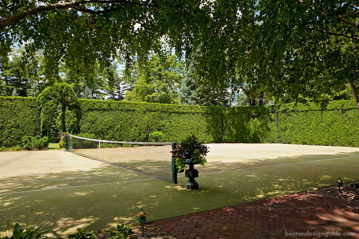 Grass tennis court designed by Sudbury Design Group